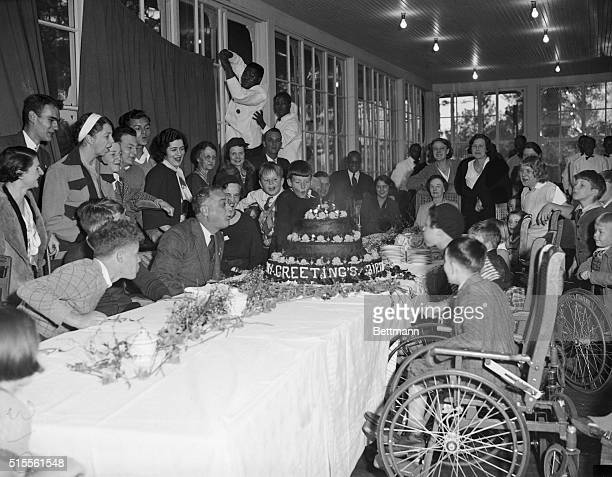 PresidentElect Celebrates Birthday Warm Springs Georgia Assisted by patients of the Warm Springs Foundation PresidentElect Franklin D Roosevelt blows...