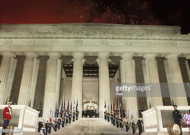 Presidentelect Donald J Trump and family stand in front of the Lincoln Memorial as fireworks expolode overhead at the inaugural concert in January 19...