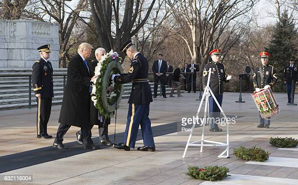 US Presidentelect Donald J Trump and US Vice Presidentelect Mike Pence participate in a wreath laying ceremony at Arlington National Cemetery on...