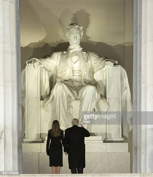 Presidentelect Donald J Trump and wife Melania Trump arrive for the inaugural concert at the Lincoln Memorial in January 19 2017 in Washington DC...