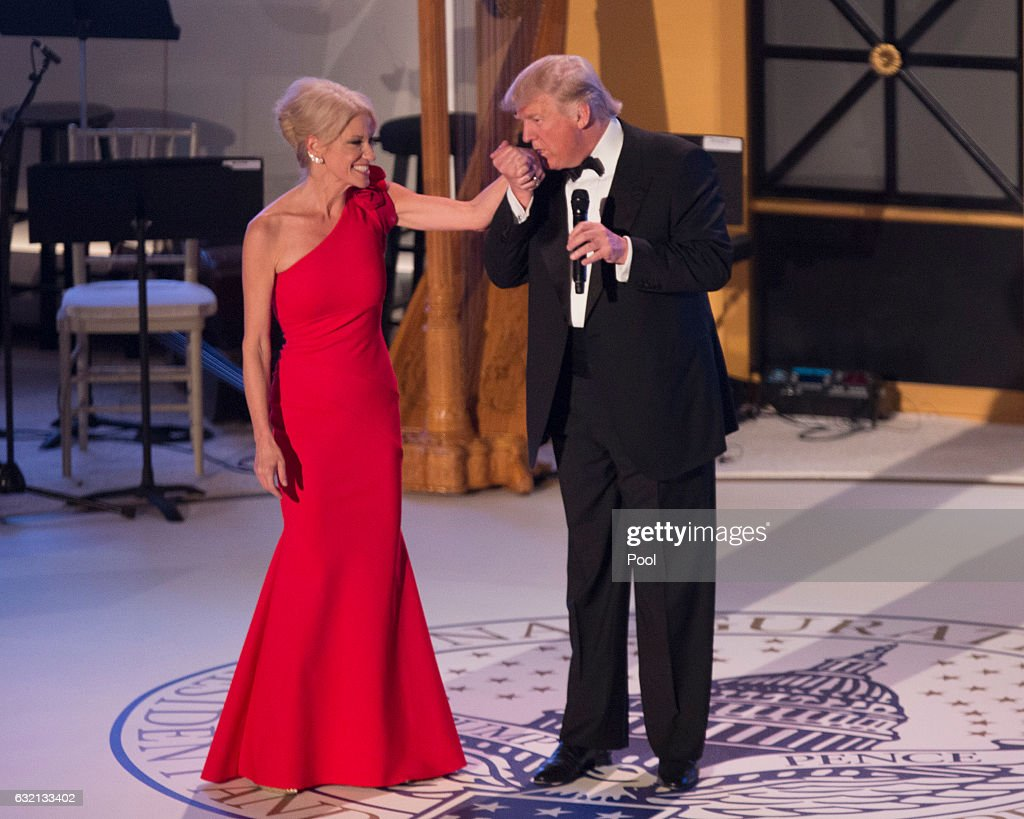 President-elect Donald J. Trump kisses the hand of campaign manager Kellyanne Conway at the Indiana Society Ball to thank donors January 19, 2017 in Washington, DC.
