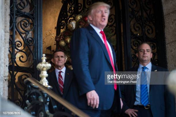 PresidentElect Donald J Trump retired US Army Lieutenant General Michael T Flynn and Chief of Staff Reince Priebus walk out to speak to members of...