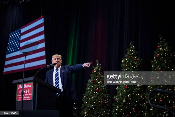 """President-Elect Donald J. Trump surrounded by christmas trees speaks during a """"USA Thank You Tour 2016"""" event in West Allis, WI on Tuesday, Dec. 13,..."""