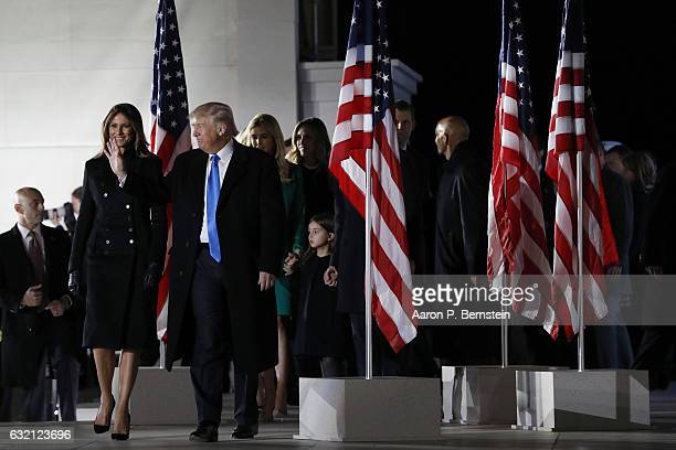 Presidentelect Donald Trump accompanied by his family walks offstage during the inauguration concert at the Lincoln Memorial January 19 2017 in...