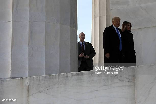 Presidentelect Donald Trump accompanied by his wife Melania Trump arrives for the inauguration concert at the Lincoln Memorial January 19 2017 in...