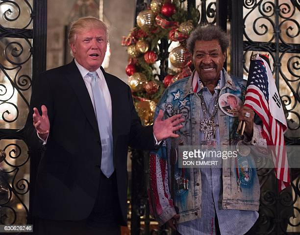President-elect Donald Trump, along with boxing promoter Don King, answers questions from the media after a day of meetings on December 28, 2016 at...
