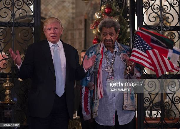 US Presidentelect Donald Trump along with boxing promoter Don King answers questions from the media after a day of meetings on December 28 2016 at...