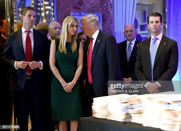 US Presidentelect Donald Trump along with his children Eric Ivanka and Donald Jr arrive for a press conference January 11 2017 at Trump Tower in New...