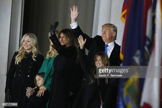 Presidentelect Donald Trump and family pose at the end of the inauguration concert at the Lincoln Memorial January 19 2017 in Washington DC Hundreds...