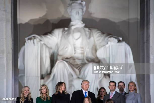 Presidentelect Donald Trump and his family stand on the steps at the Lincoln Memorial as fireworks go off during a Make America Great Again thank you...