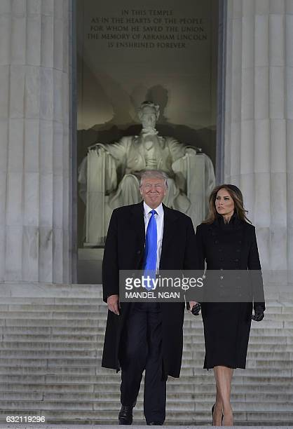 US Presidentelect Donald Trump and his wife Melania arrive to attend an inauguration concert at the Lincoln Memorial in Washington DC on January 19...