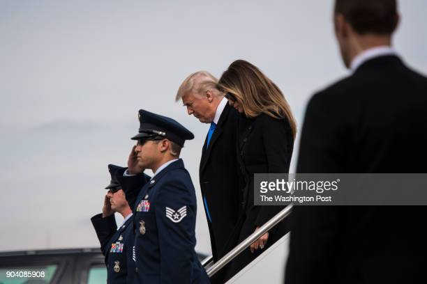 Presidentelect Donald Trump and his wife Melania disembark a plane as they arrive the day before his Inauguration at Joint Base Andrews in Joint Base...