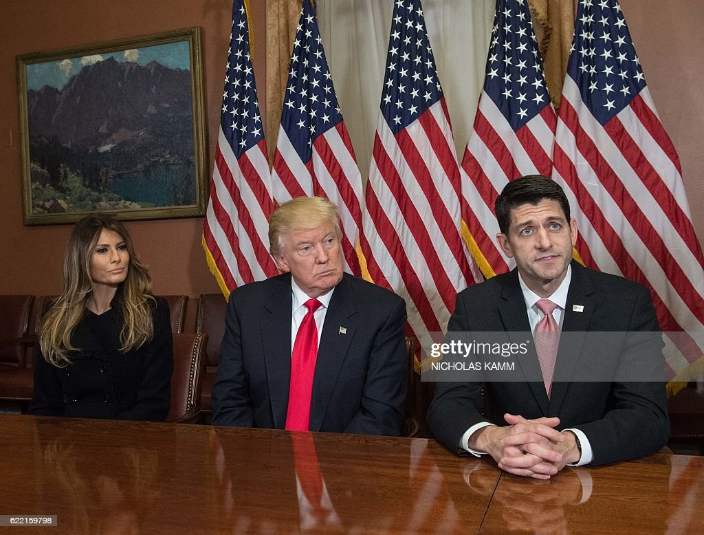 US President-elect Donald Trump (C) and his wife Melania listen to House Speaker Paul Ryan speak to the press at the US Capitol in Washington, DC, on November 10, 2016. / AFP / NICHOLAS