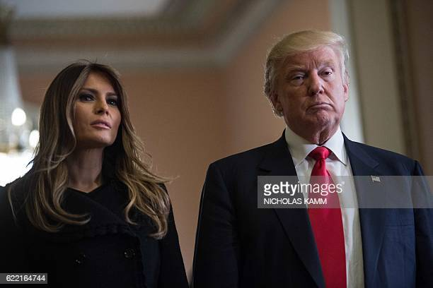 US Presidentelect Donald Trump and his wife Melania take a question from the press after a meeting with Senate Majority Leader Mitch McConnell at the...