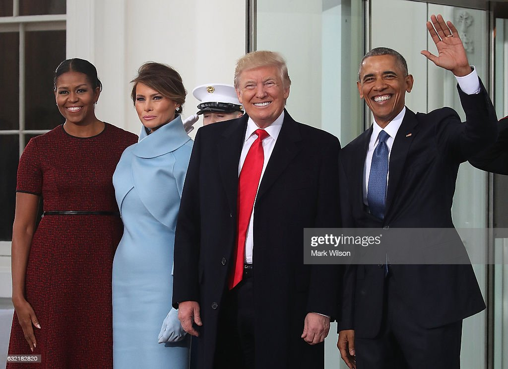 President-elect Donald Trump (2ndR),and his wife Melania Trump (2ndL), are greeted by President Barack Obama and his wife first lady Michelle Obama, upon arriving at the White House on January 20, 2017 in Washington, DC. Later in the morning President-elect Trump will be sworn in as the nation's 45th president during an inaugural ceremony at the U.S. Capitol.