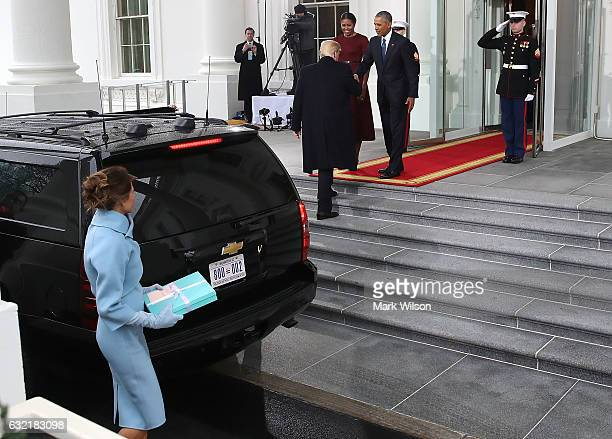 Presidentelect Donald Trump and his wife Melania Trump are greeted by President Barack Obama and his wife first lady Michelle Obama upon arriving at...