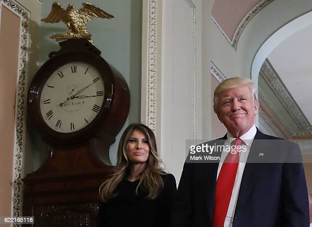 Presidentelect Donald Trump and his wife Melania Trump walk from a meeting with Senate Majority Leader Mitch McConnell at the US Capitol November 10...
