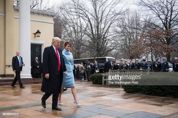 Presidentelect Donald Trump and his wife Melania walk out after a morning worship service on Inauguration day at St John's Episcopal Church in...