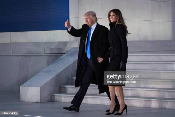 Presidentelect Donald Trump and his wife Melania walk out at the Lincoln Memorial during a Make America Great Again thank you concert in Washington...