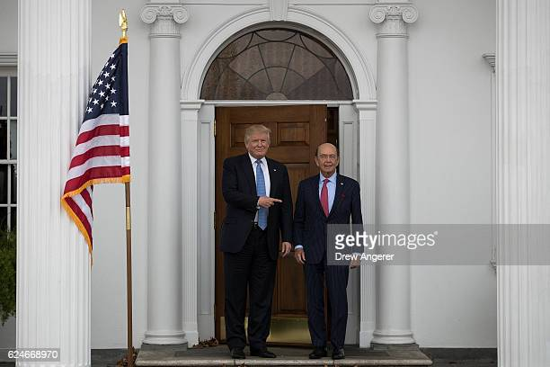 Presidentelect Donald Trump and investor Wilbur Ross pose for a photo following their meeting at Trump International Golf Club November 20 2016 in...