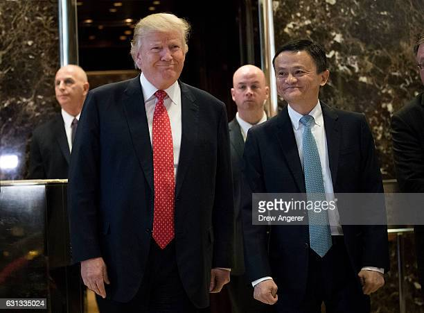 President-elect Donald Trump and Jack Ma, Chairman of Alibaba Group, emerge from the elevators to speak to reporters following their meeting at Trump...
