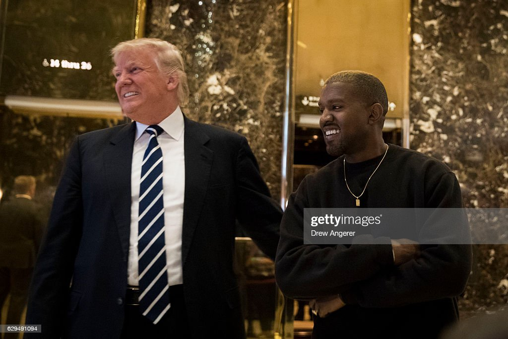 President-elect Donald Trump and Kanye West stand together in the lobby at Trump Tower, December 13, 2016 in New York City. President-elect Donald Trump and his transition team are in the process of filling cabinet and other high level positions for the new administration.