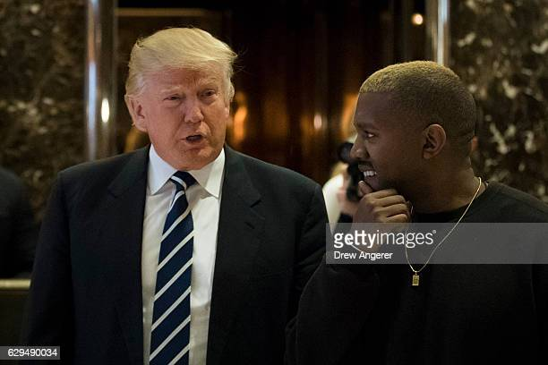 Presidentelect Donald Trump and Kanye West walk into the lobby at Trump Tower December 13 2016 in New York City Presidentelect Donald Trump and his...