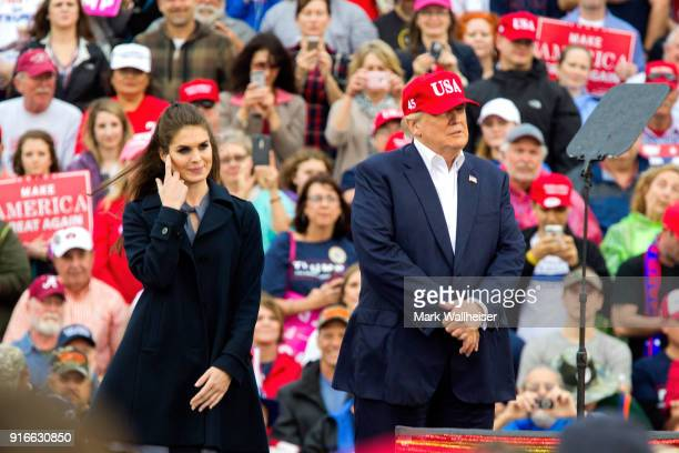 President-elect Donald Trump and press secretary Hope Hicks on stage during a 'Thank You Tour 2016' rally on December 17, 2016 in Mobile, Alabama.