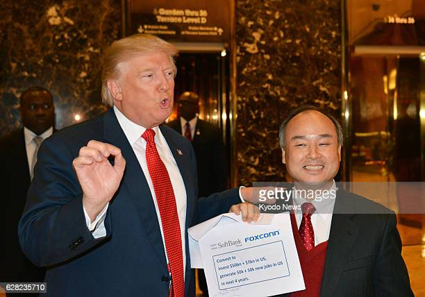 US Presidentelect Donald Trump and SoftBank Group Corp Chief Executive Officer Masayoshi Son meet with reporters following their talks at Trump Tower...