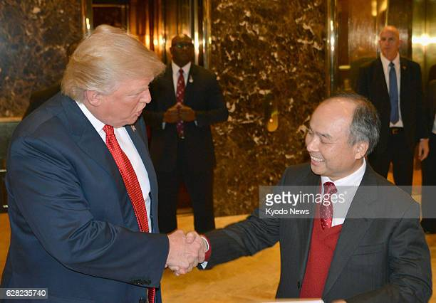 US Presidentelect Donald Trump and SoftBank Group Corp Chief Executive Officer Masayoshi Son shake hands at the lobby of Trump Tower in New York...