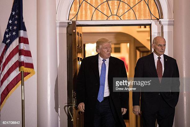 Presidentelect Donald Trump and US Marine Corps General John Kelly emerge from the clubhouse following their meeting at Trump International Golf Club...