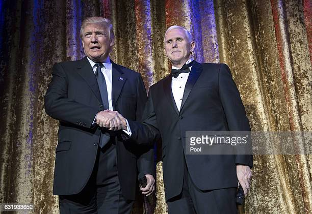 Presidentelect Donald Trump and Vice Presidentelect Mike Pence arrive on stage at the Chairman's Global Dinner at the Andrew W Mellon Auditorium on...