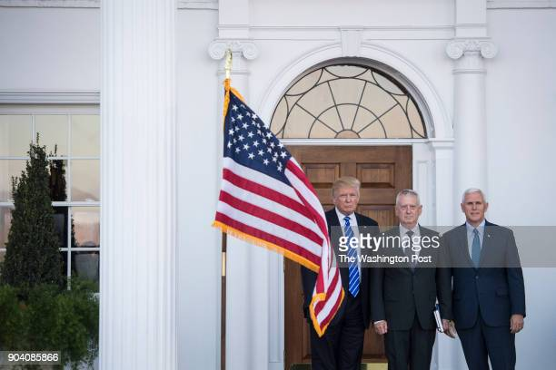 Presidentelect Donald Trump and Vice Presidentelect Mike Pence greet retired Gen James Mattis at the Trump National Golf Club Bedminster clubhouse at...