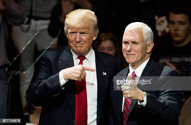 Presidentelect Donald Trump and Vice Presidentelect Mike Pence stand onstage together at US Bank Arena on December 1 2016 in Cincinnati Ohio Trump...
