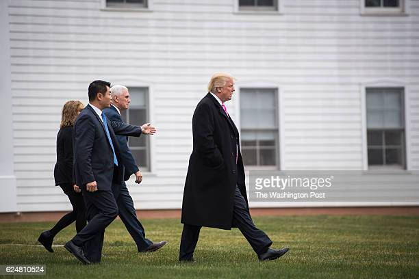 Presidentelect Donald Trump and Vice Presidentelect Mike Pence walk out from Lamington Presbyterian Church after attending services in Bedminster...