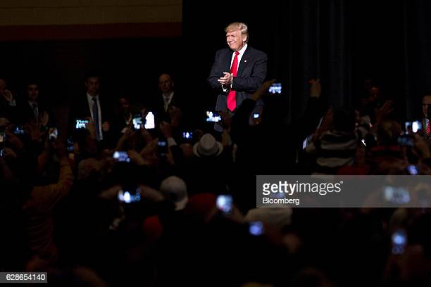 US Presidentelect Donald Trump arrives to speak during an event in Des Moines Iowa US on Thursday Dec 8 2016 Trump said China will soon have to play...