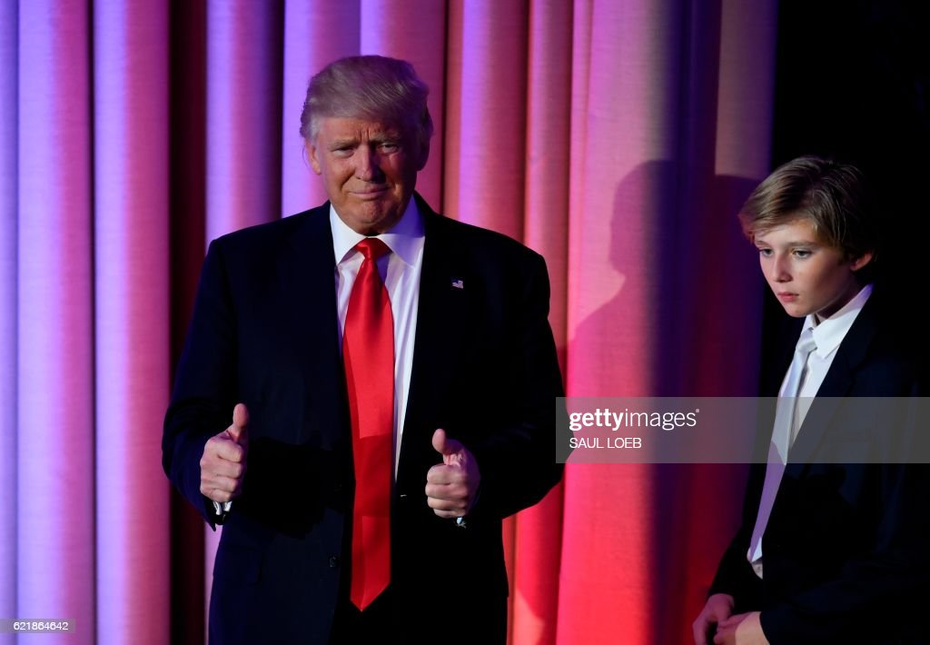 President-elect Donald Trump arrives with his son Barron at the New York Hilton Midtown in New York on November 8, 2016. Trump stunned America and the world Wednesday, riding a wave of populist resentment to defeat Hillary Clinton in the race to become the 45th president of the United States. /
