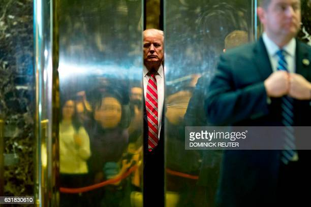 US Presidentelect Donald Trump boards the elevator after escorting Martin Luther King III to the lobby after meetings at Trump Tower in New York City...