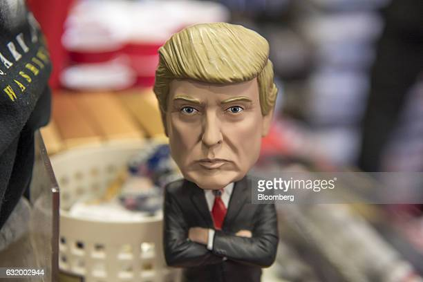 A US Presidentelect Donald Trump bobble head is displayed for sale inside the White House gift store in Washington DC US on Wednesday Jan 18 2017...