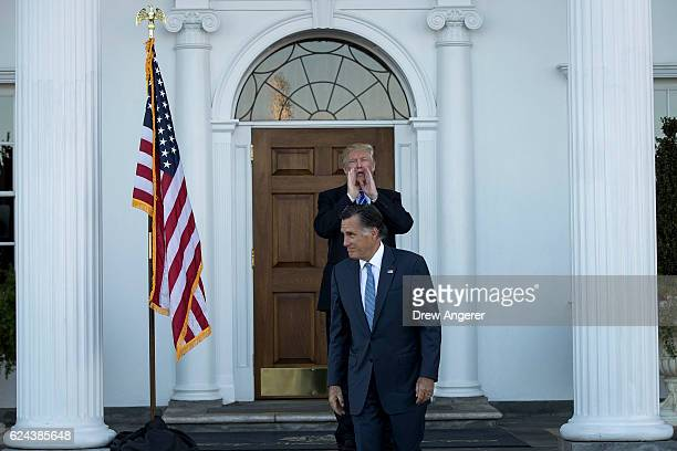 Presidentelect Donald Trump calls out to the press as Mitt Romney leaves after their meeting at Trump International Golf Club November 19 2016 in...