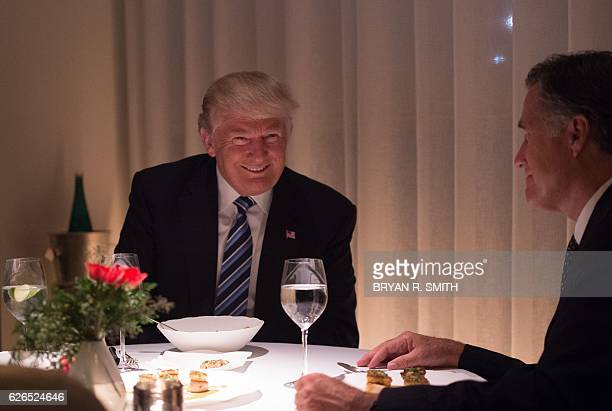 US Presidentelect Donald Trump dines with Mitt Romney at JeanGeorges restaurant at Trump International Hotel and Tower Tuesday November 29 2016 in...