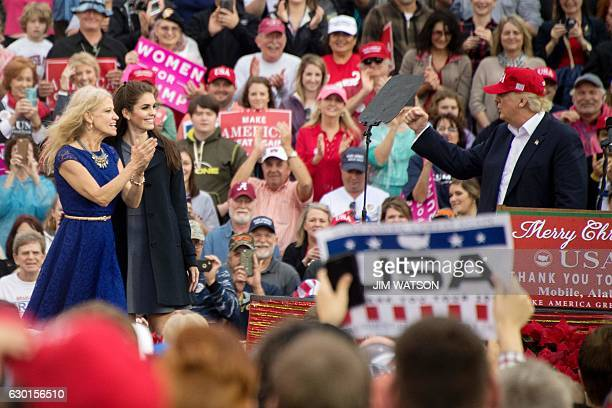 US Presidentelect Donald Trump gestures as he thanks his campaign manager Kellyanne Conway and press secretary Hope Hicks during a 'Thank You Tour...