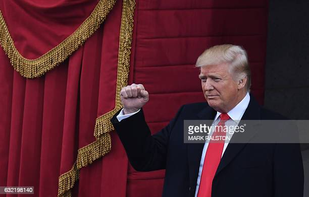 US Presidentelect Donald Trump gestures before being sworn in as President on January 20 2017 at the US Capitol in Washington DC / AFP / Mark RALSTON
