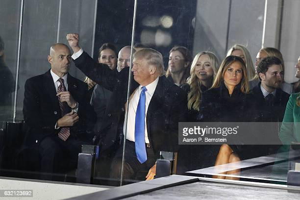 Presidentelect Donald Trump gestures to the crowd during the inauguration concert at the Lincoln Memorial January 19 2017 in Washington DC Hundreds...