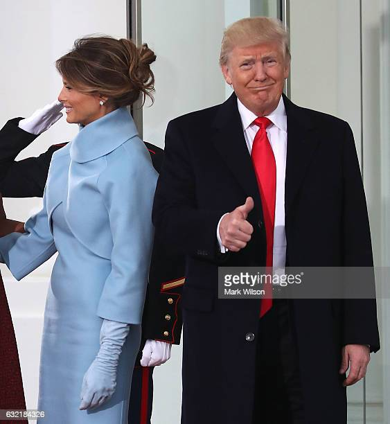 Presidentelect Donald Trump gives a thumbs up while he and his wife Melania Trump are greeted by President Barack Obama and his wife first lady...
