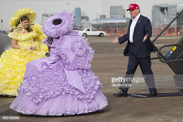 US Presidentelect Donald Trump greets members of the Azalea Trail Maids as he arrives in Mobile Alabama for a 'Thank You Tour 2016' rally on December...