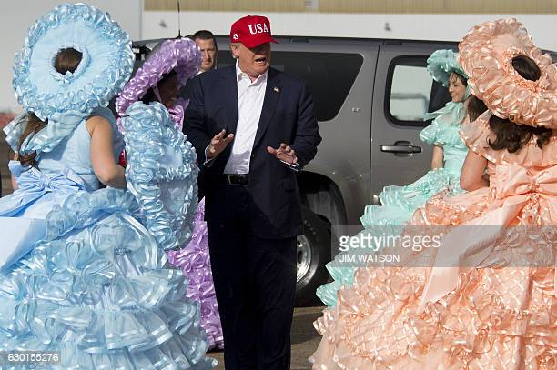 Presidentelect Donald Trump greets members of the Azalea Trail Maids as he arrives in Mobile Alabama for a 'Thank You Tour 2016' rally on December 17...