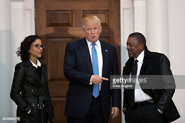President-elect Donald Trump greets Robert Johnson , the founder of Black Entertainment Television, and his wife Lauren Wooden as they arrive for a...