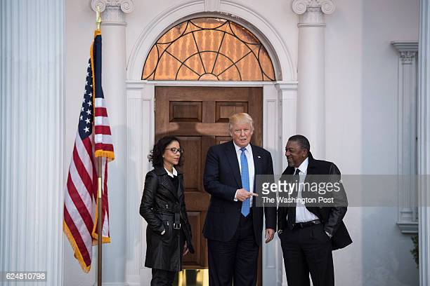 Presidentelect Donald Trump greets Robert Johnson the founder of Black Entertainment Television before a meeting at the clubhouse at Trump National...