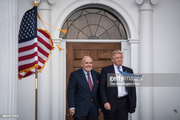 Presidentelect Donald Trump greets Rudy Giuliani at the clubhouse at Trump National Golf Club Bedminster in Bedminster Township NJ on Sunday Nov 20...